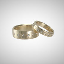 Custom Wedding Rings in Yellow Gold with White Diamonds
