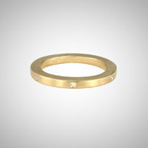 Narrow Yellow Gold Band with White Diamonds